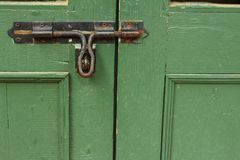 Lock of the door locked with padlock. Royalty Free Stock Photos