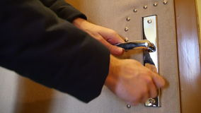 Lock the Door. A man locks the safety lock. Audio is included stock video
