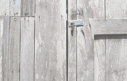 Lock the door retro wooden door and antique lock door thai old style.Background closeup wooden door with lock. stock images