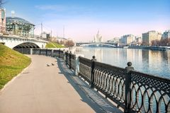 Lock embankment at the Moskva River. On the left, the House of Music and Lock Bridge, in the distance - a skyscraper on Kotelnicheskaya Embankment and Big royalty free stock images