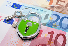 Lock and euros. Euro notes with green pad lock on top Stock Photos