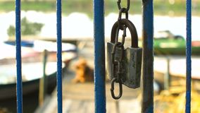 Lock fence gate. No entry via this padlocked chain linked fence gate stock footage