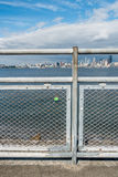 Lock On Fence With Seattle Skyline Stock Photo