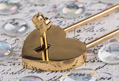 Lock in the form of a heart with key Royalty Free Stock Photos