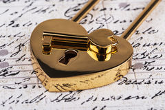 Lock in the form of a heart with key Stock Photo