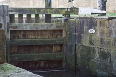 Lock Gate. A close up shot of a wooden lock gate on the Leeds Liverpool canal near Wigan Pier Royalty Free Stock Photography
