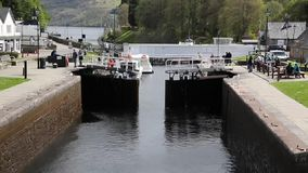 Lock gates closing Caledonian Canal Fort Augustus Scotland UK which connects Fort William to Inverness Loch ness stock video footage