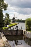 Lock gates and Dutch windmill Stock Photos