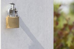 Lock on the gold metal door. Close-up stock photos