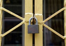 The lock on the gold metal fence, shape of the fence look like X stock photography