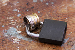 Lock with gold and silver engagement rings Stock Photo
