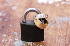 Lock with gold and silver engagement rings Stock Image