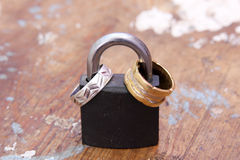 Lock with gold and silver engagement rings Royalty Free Stock Images