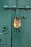 The lock on green doors Royalty Free Stock Photo