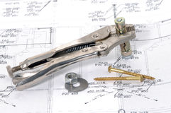 Lock grip pliers over house plan. For construction or reconstruction Royalty Free Stock Images