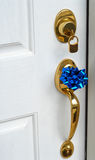 Lock and handle on door. Of new home with a bow on the handle Stock Photos