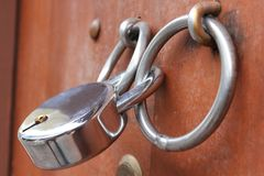 Locking lever on the handle of the wooden door. royalty free stock photography