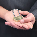 The lock in hands Stock Photography