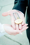 The lock in hands of newlyweds stock photography