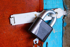 Lock hanging on the door Royalty Free Stock Image