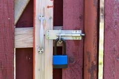 Lock hanging on the door Stock Photo