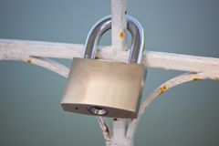 Lock hanging on the fence Royalty Free Stock Images