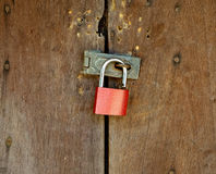 Lock hanging on padlock with wooden background Royalty Free Stock Photos