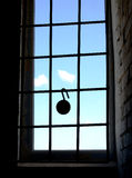Lock hanging on the window grille. Window is closed with metal bars Royalty Free Stock Images