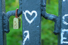 Lock & heart. Lock hanging on the fence Stock Photography