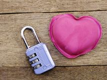 Lock with the heart as a symbol of love on wooden background. Lock with the heart as a symbol of love vintage on wooden background stock photo