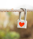 Lock with heart symbol on rope bridge as a promise of  lover Stock Photography