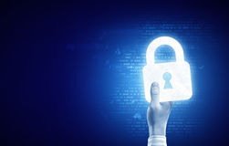 Lock icon. Close up of human hand with digital lock icon Stock Image