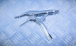 Lock jaw pliers on channeled metal background construction conce Stock Photography