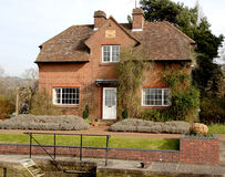 Lock-Keeper's House. Red Bricked Lock Keeper`s House on the River Thames in England Royalty Free Stock Images
