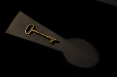 Lock And Key 1. Antique skeleton key in an inverted lock shadow Stock Photography