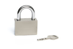 Lock with key. Closed steel padlock with key. Background white Royalty Free Stock Photos