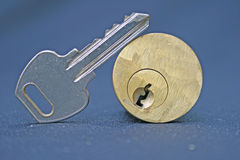 Lock and key. Door key and keyhole part of a door lock with key leaning on lock Stock Photo