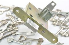 Lock and key. Against white background Royalty Free Stock Photography