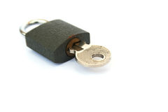 Lock and key. Closed lock and key isolated on white background Royalty Free Stock Photo