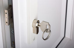 Lock and key. Plastic white door, lock and key Stock Images