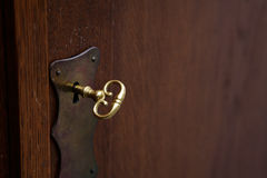 Lock and Key. The picture of an old wooden furniture Royalty Free Stock Photos
