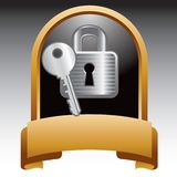 Lock and key in gold display Stock Photos