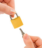 Lock and key in hands Stock Image