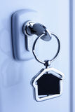 Lock and key with metal house figure Stock Photography