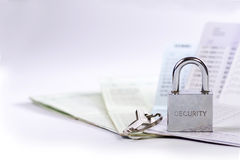 Lock and key on passbook Stock Images