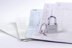 Lock and key on passbook Royalty Free Stock Photos