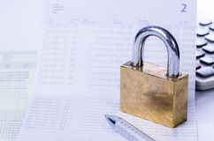 Lock and key on passbook Royalty Free Stock Images
