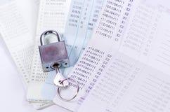 Lock and key on passbook Royalty Free Stock Photos