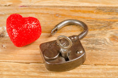 Lock and key to a heart stock photos