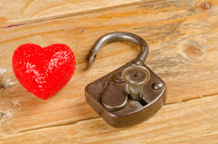 Lock and key to a heart Stock Photo